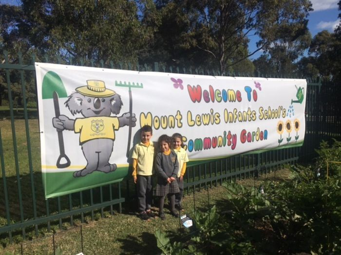 Students with community garden banner